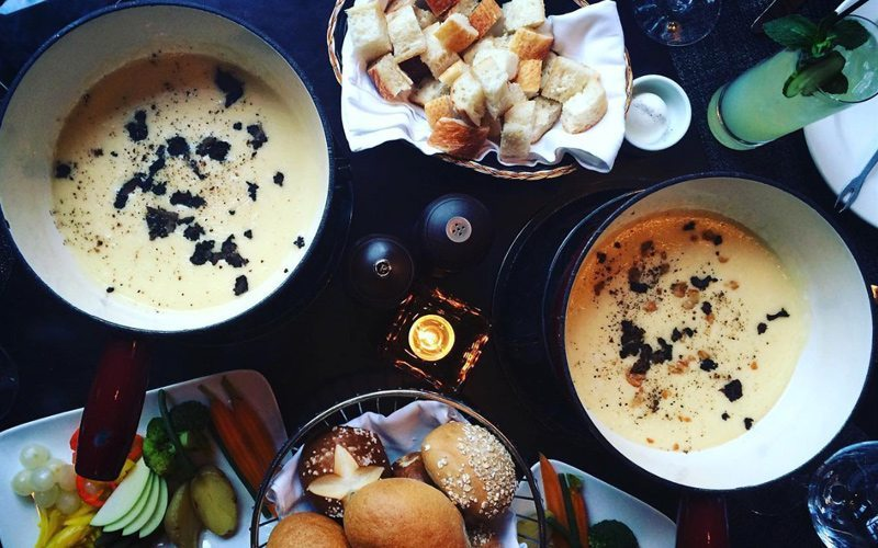 Walliser Stube's cheese fondue is the perfect way to indulge at Fairmont Chateau Lake Louise. Photo: @vickiarkoff on Instagram.