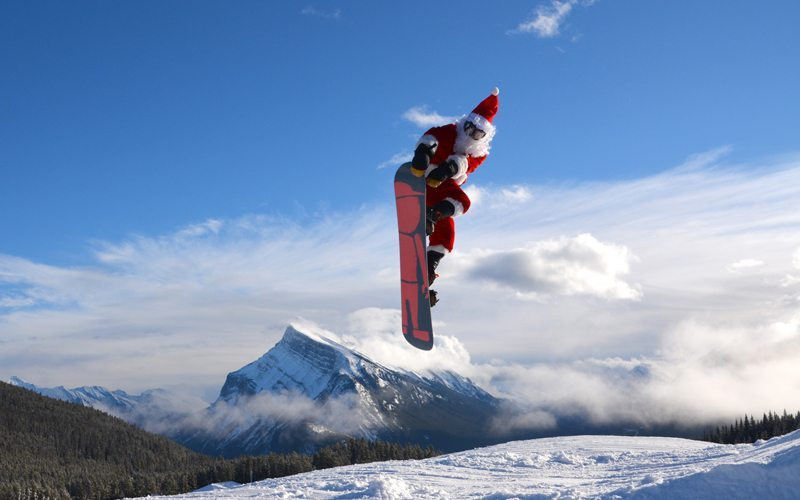 He's making a list and dropping in twice. Santa shreds for free on Christmas Day at Mt Norquay! Photo: Tyler Parker