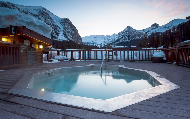 The outdoor hot pool at Deer Lodge is an excellent choice after a day at Lake Louise Ski Resort. Photo: Ben Girardi.