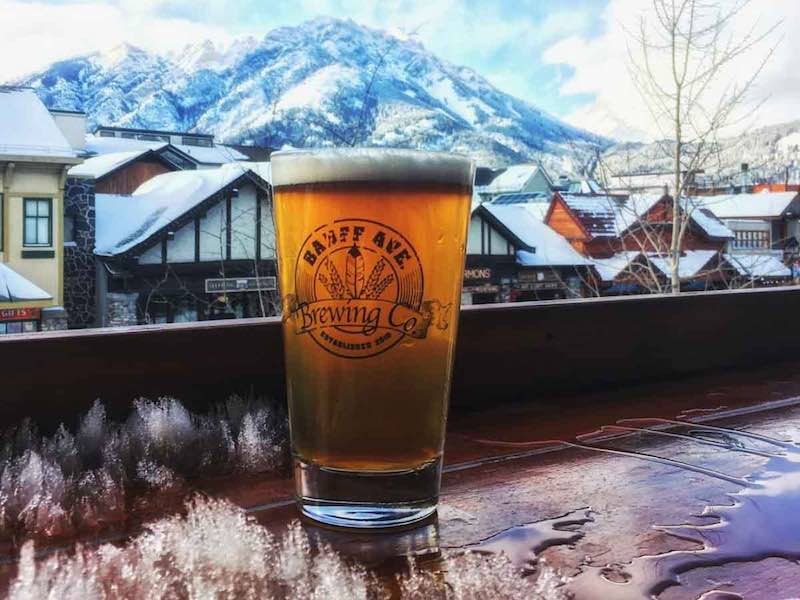 Pint on the patio of Banff Avenue Brewing Co. in Banff, Alberta.
