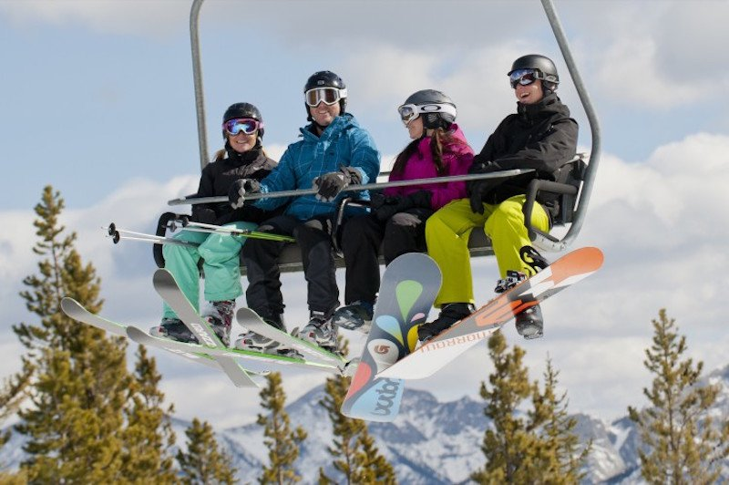 Skiers on chairlift