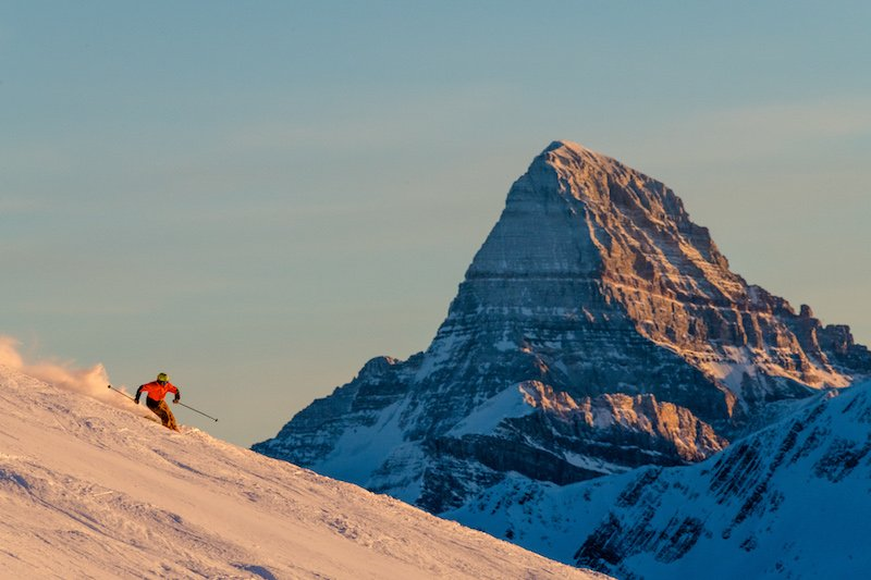 skier at Banff Sunshine Village, with Mount Assiniboine