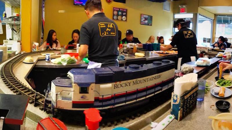 Train goes around chef at Sushi House in Banff, Alberta.