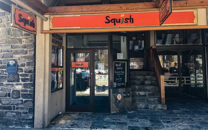Exterior street view of Squish Sandwich Cellar in Banff, Alberta.