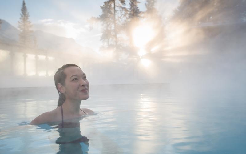 Enjoying the natural thermal waters at the Banff Upper Hot Springs. Photo by Banff & Lake Louise Tourism / Noel Hendrickson.