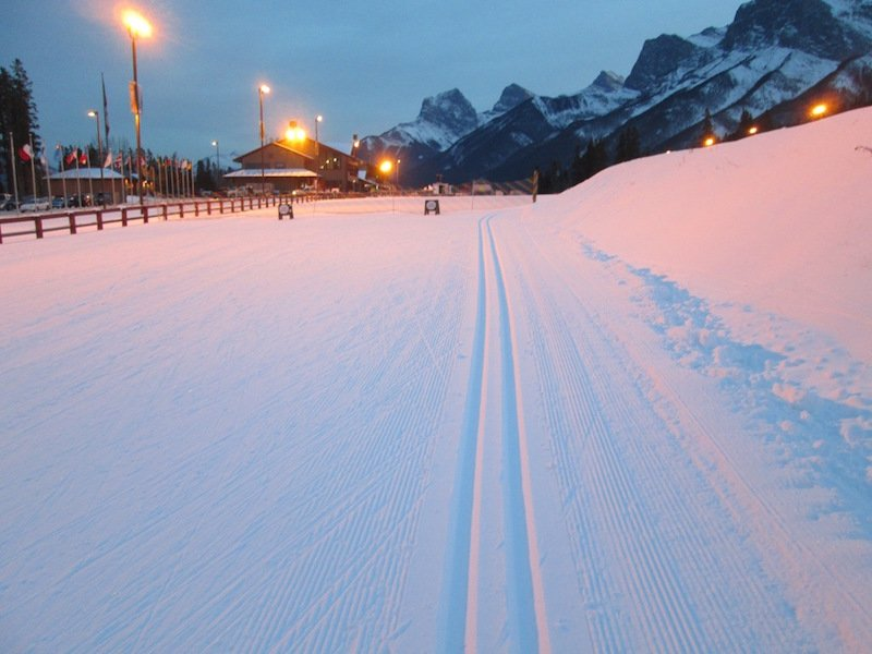 Illuminated cross-country ski track at Canmore Nordic Centre, Canmore, Alberta.