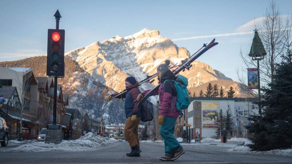 Skiers crossing Banff Ave, Banff National Park.