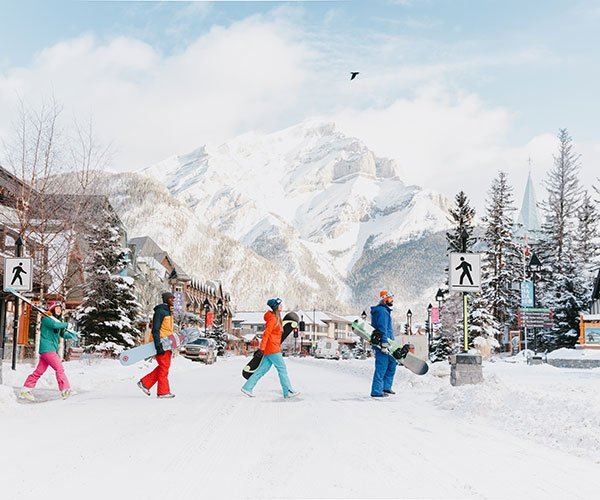 Skiers and Snowboarders crossing Banff Ave, Banff National Park.
