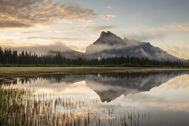 Sunrise view of Mount Rundle from Vermillion Lakes in Banff National Park.