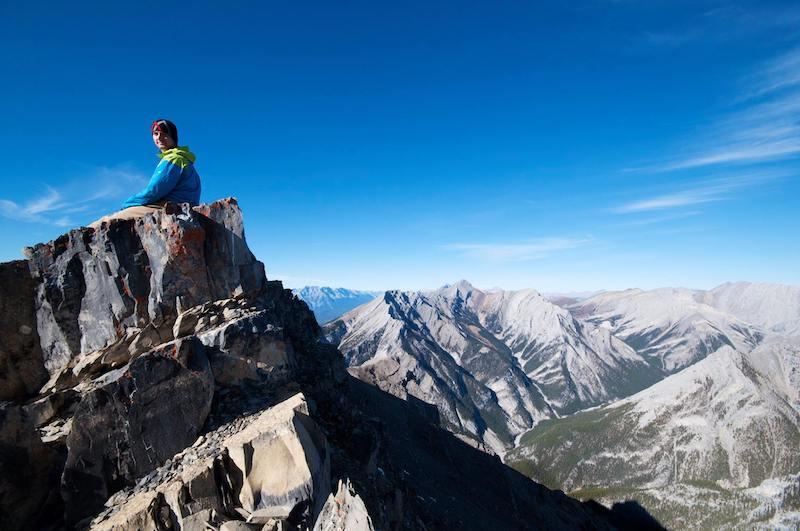 Hiker on ridge of Grotto Mountain near Canmore, Alberta.