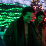 Couple enjoying Christmas lights in Banff, Alberta.