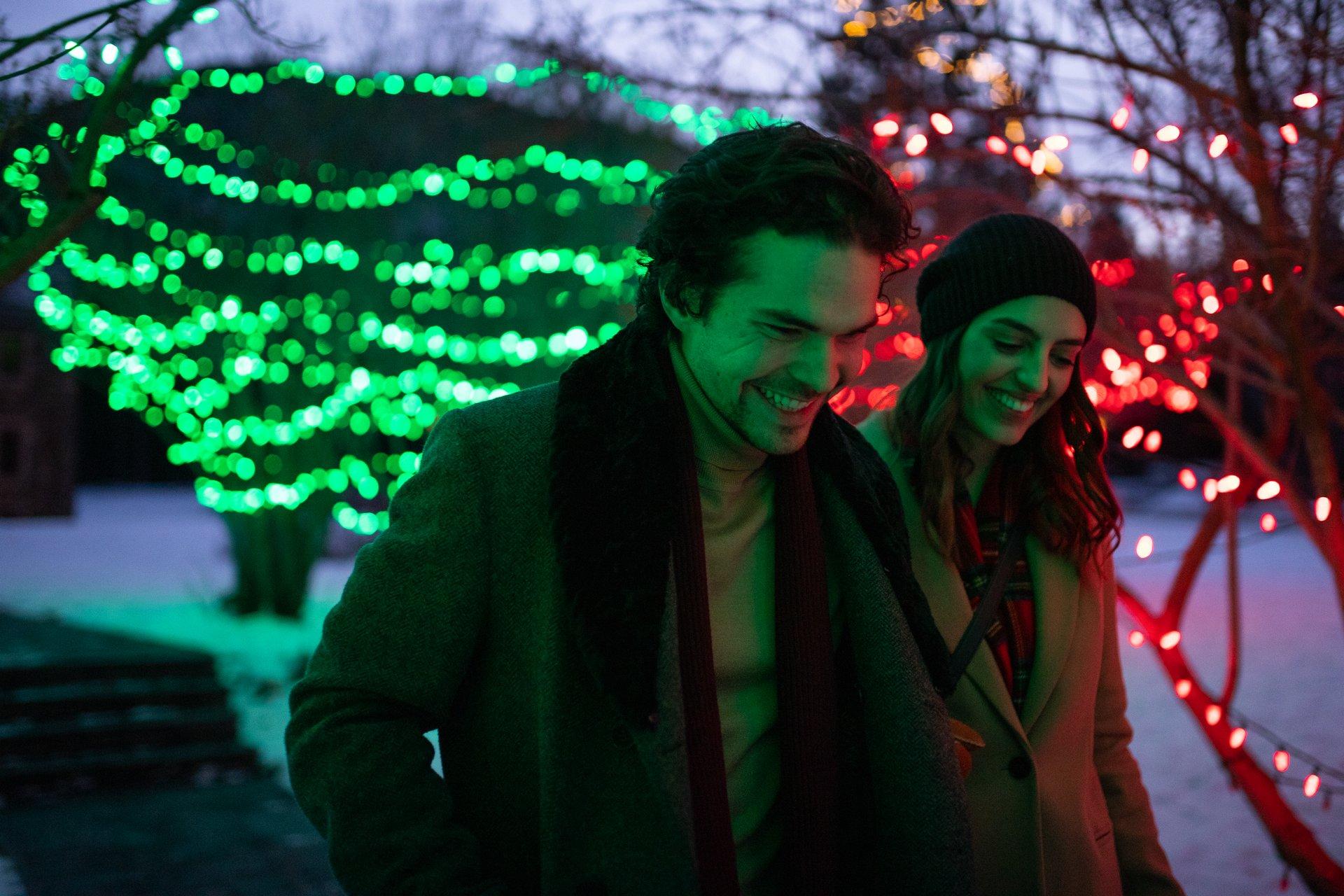 Couple enjoying Christmas lights in Banff, Alberta.