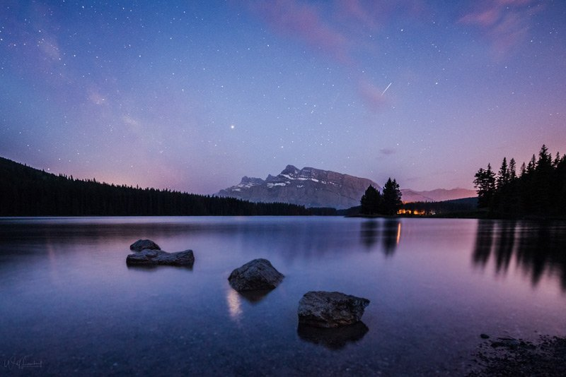 Night skies over Mount Rundle from Two Jack Lake, Banff National Park.
