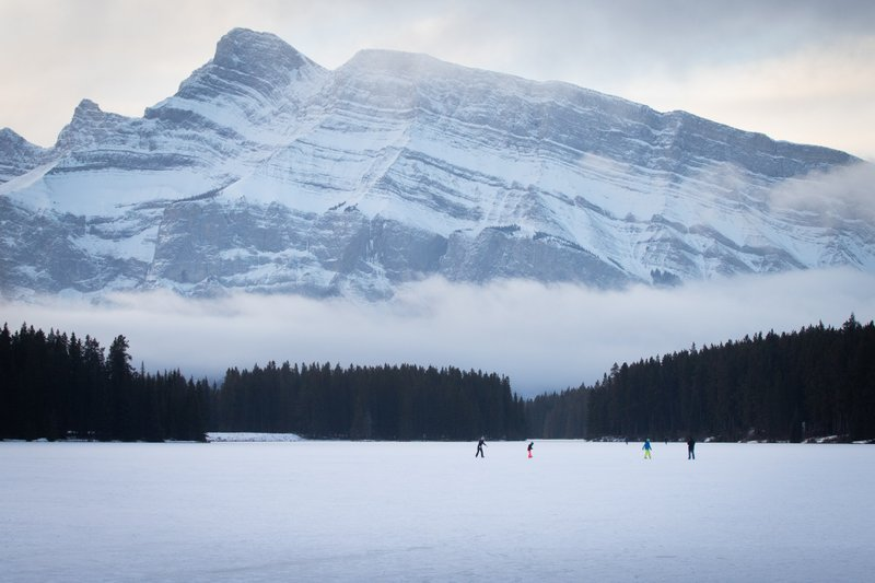 Wilderness ice skating on Two Jack Lake in Banff National Park.