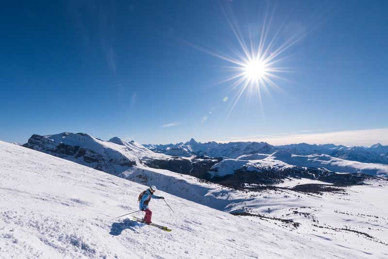 Skier and view of Mt. Assiniboine at Banff Sunshine Village in Banff National Park.