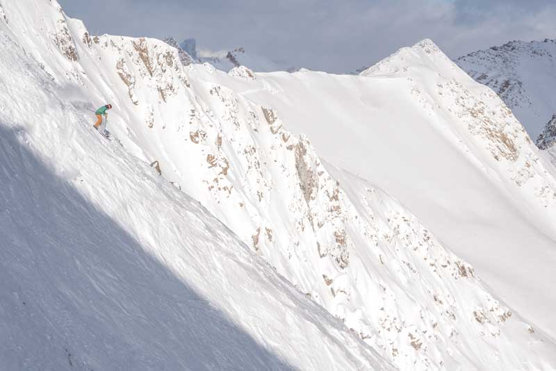 Skier in the back bowls at Lake Louise Ski Resort, Banff National Park.