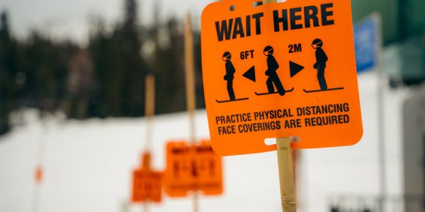 Social distancing marker signs at Banff Sunshine Village, Banff National Park.
