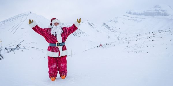 Santa at Lake Louise Ski Resort.|Santa and Mrs. Claus with their skis at Banff Sunshine Village