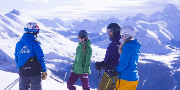 Group of skiers on a guided adventure at Sunshine Village|Sunshine Village by Devaan Ingraham|Club Ski lessons will take your vacation to the next level. Photo: Mark Walker at Lake Louise Ski Resort.|The excitement of a shared challenge is a great opportunity to meet new people. Photo: Mt Norquay.|Build your skills rapidly and get the inside scoop from our expert Club Ski instructors. Photo: Devaan Ingraham at Sunshine Village.|Club Ski has you covered