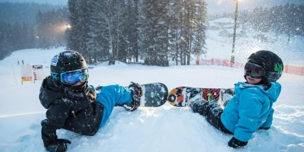Boys snowboarding at Mt. Norquay